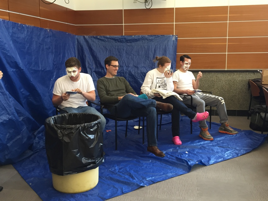 Ambassadors take pie to the face for change
